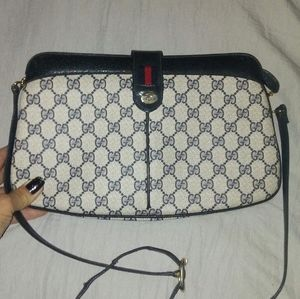 Vintage Gucci with leather buckled strap